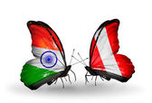 Two butterflies with flags on wings as symbol of relations India and Peru — Stock Photo