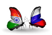 Two butterflies with flags on wings as symbol of relations India and Russia — Stock Photo
