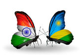 Two butterflies with flags on wings as symbol of relations India and Rwanda — Stock Photo