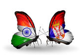 Two butterflies with flags on wings as symbol of relations India and Serbia — Stock Photo