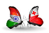 Two butterflies with flags on wings as symbol of relations India and Tonga — Stock Photo
