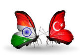Two butterflies with flags on wings as symbol of relations India and Turkey — Stock Photo