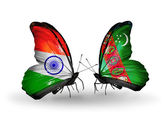 Two butterflies with flags on wings as symbol of relations India and Turkmenistan — Stock Photo
