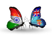 Two butterflies with flags on wings as symbol of relations India and Fiji — Stock Photo