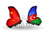 Two butterflies with flags on wings as symbol of relations China and Azerbaijan — Стоковое фото
