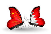 Two butterflies with flags on wings as symbol of relations China and Bahrain — Stock Photo