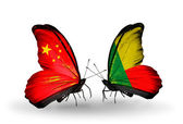 Two butterflies with flags on wings as symbol of relations China and Benin — Stock Photo