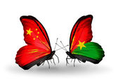 Two butterflies with flags on wings as symbol of relations China and Burkina Faso — Stock Photo