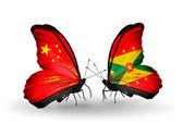 Two butterflies with flags on wings as symbol of relations China and Grenada — Stock Photo