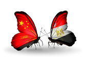 Two butterflies with flags on wings as symbol of relations China and Egypt — Stockfoto