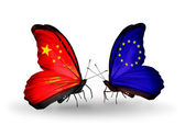 Two butterflies with flags on wings as symbol of relations China and EU — Stock Photo