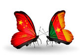 Two butterflies with flags on wings as symbol of relations China and Cameroon — Stock Photo