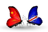 Two butterflies with flags on wings as symbol of relations China and Cape Verde — Stock Photo