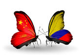 Two butterflies with flags on wings as symbol of relations China and Columbia — Stock Photo