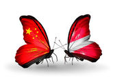 Two butterflies with flags on wings as symbol of relations China and Latvia — Photo