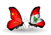 Two butterflies with flags on wings as symbol of relations China and Lebanon — Stock Photo