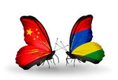 Two butterflies with flags on wings as symbol of relations China and Mauritius — Stock Photo