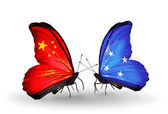 Two butterflies with flags on wings as symbol of relations China and Micronesia — Stock Photo