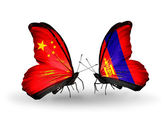 Two butterflies with flags on wings as symbol of relations China and Mongolia — Stock Photo