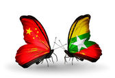 Two butterflies with flags on wings as symbol of relations China and Myanmar — Stock Photo