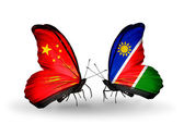 Two butterflies with flags on wings as symbol of relations China and Namibia — Stock Photo