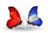 Two butterflies with flags on wings as symbol of relations China and Nicaragua — Stock Photo