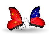 Two butterflies with flags on wings as symbol of relations China and Samoa — Stock Photo