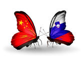 Two butterflies with flags on wings as symbol of relations China and Slovenia — Stock Photo