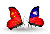 Two butterflies with flags on wings as symbol of relations China and Taiwan — Stock Photo