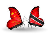Two butterflies with flags on wings as symbol of relations China and Trinidad and Tobago — Стоковое фото