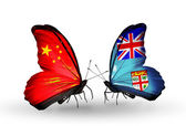 Two butterflies with flags on wings as symbol of relations China and Fiji — Stock Photo