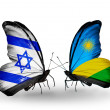 Stock Photo: Two butterflies with flags on wings as symbol of relations Israel and Rwanda