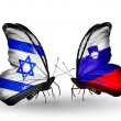 Stock Photo: Two butterflies with flags on wings as symbol of relations Israel and Slovenia