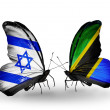 Stock Photo: Two butterflies with flags on wings as symbol of relations Israel and Tanzania