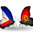 Two butterflies with flags on wings as symbol of relations Philippines and Angola — Stock Photo #37669367