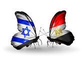 Duas borboletas com bandeiras nas asas como símbolo das relações, israel e egito — Fotografia Stock
