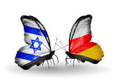 Two butterflies with flags on wings as symbol of relations Israel and South Ossetia — Stock Photo