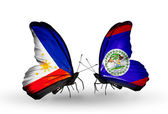 Two butterflies with flags on wings as symbol of relations Philippines and Belize — Stock Photo