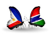 Two butterflies with flags on wings as symbol of relations Philippines and Gambia — Stock Photo