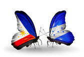 Two butterflies with flags on wings as symbol of relations Philippines and Honduras — Stock Photo