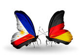 Two butterflies with flags on wings as symbol of relations Philippines and Germany — Stock Photo