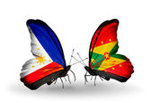 Two butterflies with flags on wings as symbol of relations Philippines and Grenada — Stock Photo