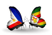 Two butterflies with flags on wings as symbol of relations Philippines and Zimbabwe — Stock Photo