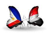 Two butterflies with flags on wings as symbol of relations Philippines and Yemen — Stock Photo
