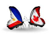 Two butterflies with flags on wings as symbol of relations Philippines and Canada — Stock Photo