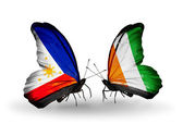 Two butterflies with flags on wings as symbol of relations Philippines and Cote Divoire — Stock Photo