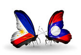 Two butterflies with flags on wings as symbol of relations Philippines and Laos — Stock Photo
