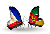 Two butterflies with flags on wings as symbol of relations Philippines and Mozambique — Stock Photo