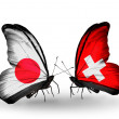 Two butterflies with flags on wings as symbol of relations Japan and Switzerland — Stock Photo #37670975