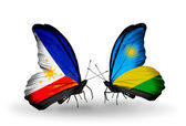 Two butterflies with flags on wings as symbol of relations Philippines and Rwanda — Stock Photo